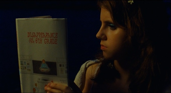 Suzy reads Disappearance of the Sixth Grade by Burris Burris